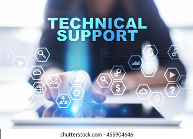 "Woman is using tablet pc, pressing on virtual screen and select ""Technical support""."