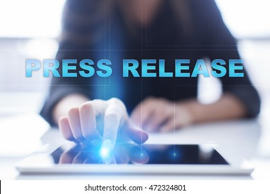 """Woman is using tablet pc, pressing on virtual screen and select """"Press Release"""""""