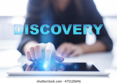 """Woman is using tablet pc, pressing on virtual screen and select """"Discovery""""."""