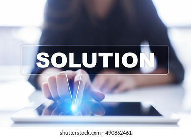 """Woman is using tablet pc, pressing on virtual screen and selecting """"Solution""""."""