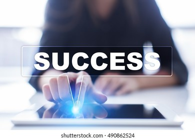 """Woman is using tablet pc, pressing on virtual screen and selecting """"Success""""."""