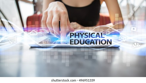 "Woman is using tablet pc, pressing on virtual screen and selecting ""Physical education""."