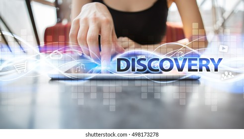 """Woman is using tablet pc, pressing on virtual screen and selecting """"Discovery""""."""