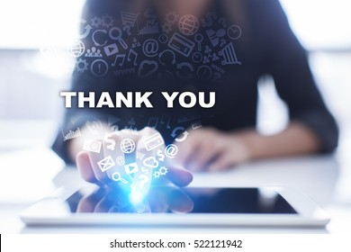 Woman is using tablet pc, pressing on virtual screen and selecting thank you.