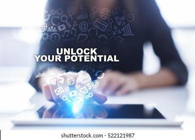 Woman is using tablet pc, pressing on virtual screen and selecting unlock your potential.