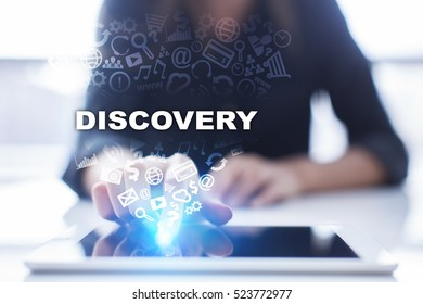 Woman is using tablet pc, pressing on virtual screen and selecting discovery.