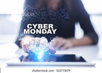 Woman is using tablet pc, pressing on virtual screen and selecting cyber monday.