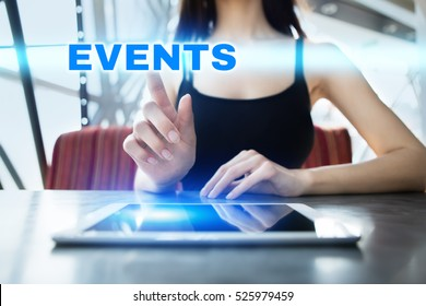 Woman is using tablet pc, pressing on virtual screen and selecting events.