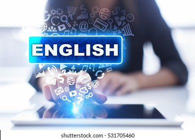 Woman is using tablet pc, pressing on virtual screen and selecting english.