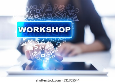 Woman is using tablet pc, pressing on virtual screen and selecting workshop.