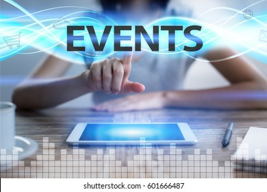 Woman using tablet pc, pressing on virtual screen and selecting events.