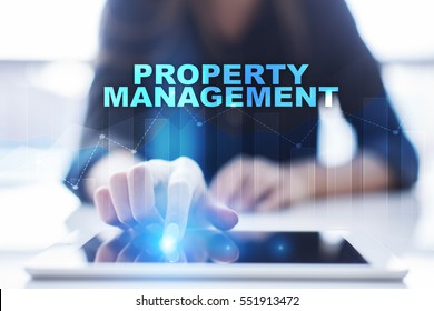 Woman using tablet pc and selecting property management.