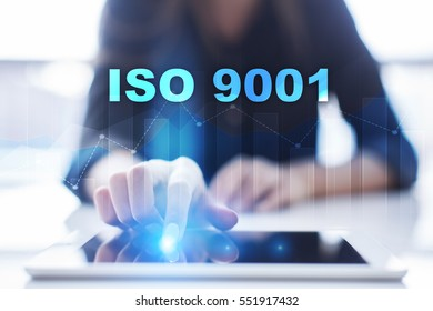 Woman using tablet pc and selecting iso 9001.