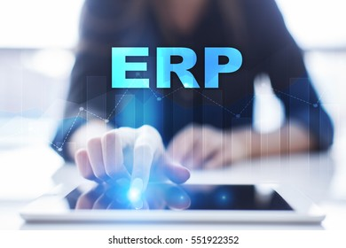 Woman using tablet pc and selecting erp.