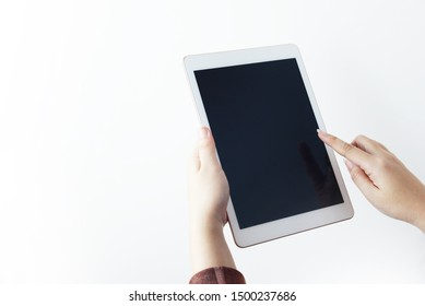 A woman is using tablet with white background isolated.