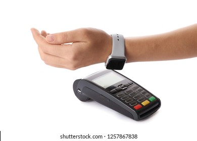 Woman using terminal for contactless payment with smart watch on white background