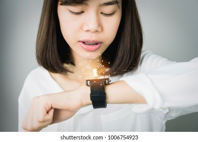 Woman using voice commands in digital clock in the display and technology advances in communication. This is a new technology. That makes life more comfortable.