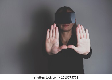 Woman is using vr glasses