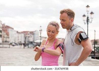 Woman using wearable technology during workout