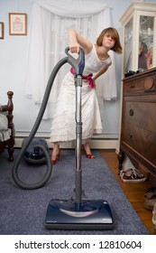 Woman Vacuuming in Formal Gown