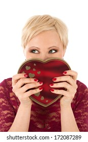Woman with valentine's gift looking funny