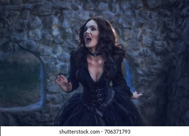 woman vampire in a ruined old castle at night