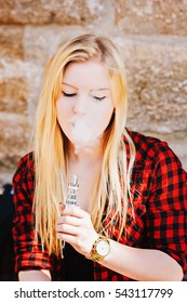 Woman vaping in smoke cloud
