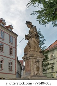 Woman with a vase or Nymph fountain in Frantiskanske namestie, Old Town. Bratislava, Slovakia.