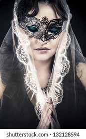 Woman in veil and black dress, glamour scene