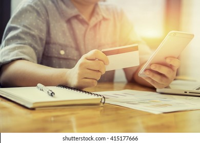 Woman verifies credit card account balance on smartphone with mobile banking application.Online payment shopping,selective focus,vintage color