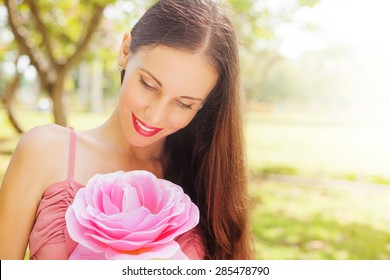 woman with the very big flower