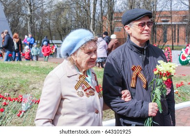 A woman is a veteran with her son. Kirishi, Russia - 9 May, 2017. Laying wreaths and flowers in memory of the fallen at the Eternal Flame.
