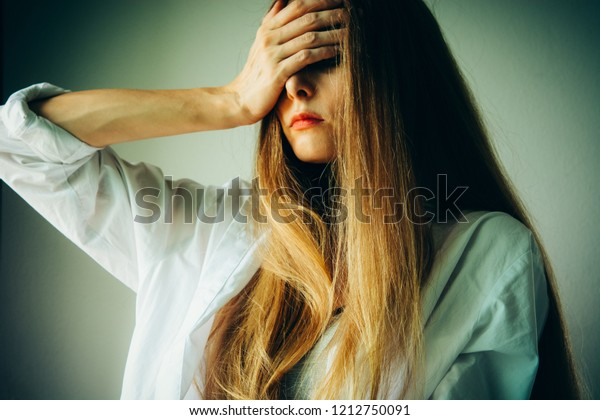 Woman victim suffering from abuse, harassment. Domestic violence, depression or heartbreak.