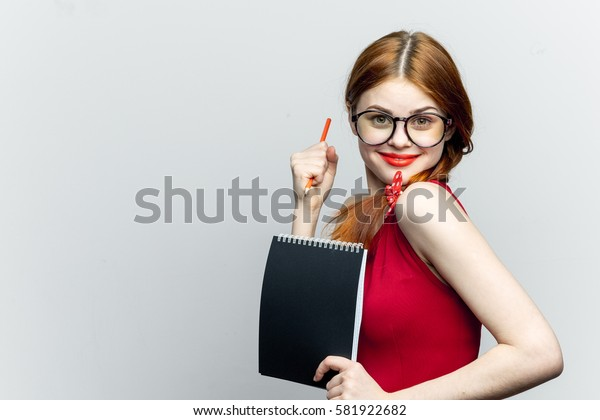 Woman victory happy bright woman with note-pad, light background