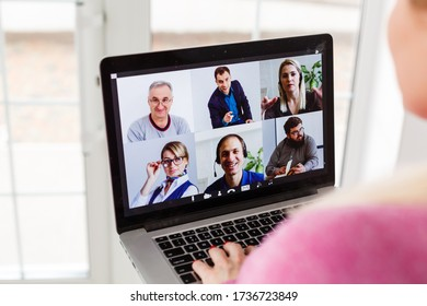 Woman video conferencing with tutor on laptop at home. Distance education concept. - Shutterstock ID 1736723849
