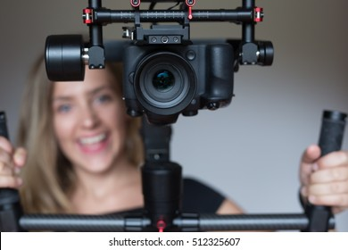 woman videographer using steady cam, Professional equipment helps to make high quality video