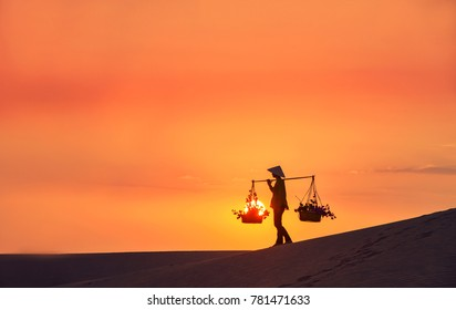 woman with Vietnam culture traditional dress on sandune during sunset ,traditional costume ,Muine Vietnam