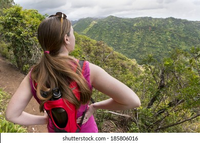 woman viewing beautiful Hawaiian landscape from Aiea Loop Trail, Oahu, Hawaii.