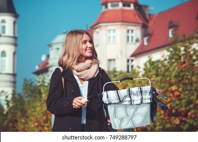 Woman with vintage bike in the autumn city
