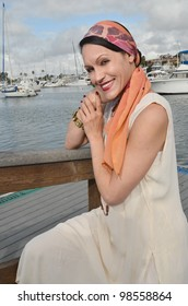 Woman in vintage clothing at the harbor/Vintage Clothing/Nostalgia Woman in Vintage Clothes