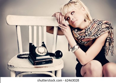 woman with vintage  phone waiting call