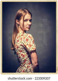 woman vintage studio portrait with red hair and  dress with flower