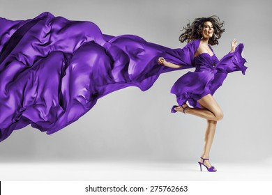 Woman in violet waving dress with flying fabric This photo has cut contours Dress! (in Photoshop)