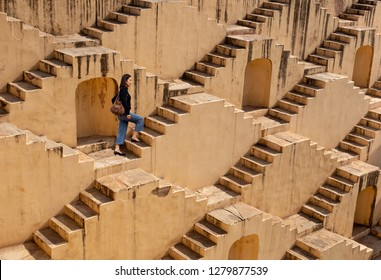 Woman visit the ancient Indian step well in Jaipur, India.