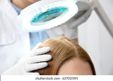 Woman visiting dermatologist at clinic