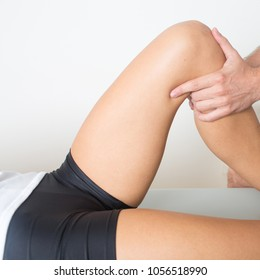 Woman visiting doctor because of sports injury