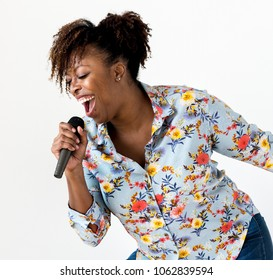 A woman vocalist singing karaoke