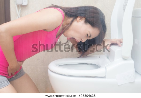 woman are vomiting in the bathroom