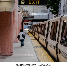 Woman waiting for BART (Bay Area Rapid Transit) train.