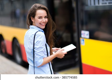 Woman waiting at bus stop